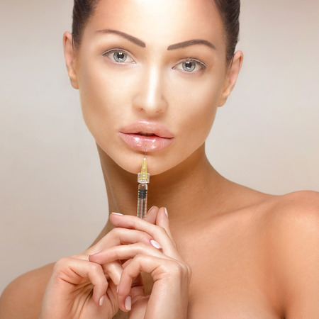 healthcare: Beauty portrait of attractive woman giving botox injections. Stock Photo
