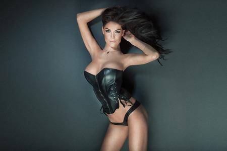 nude adult: Sexy beautiful brunette woman posing wearing black lingerie. Erotic photo.