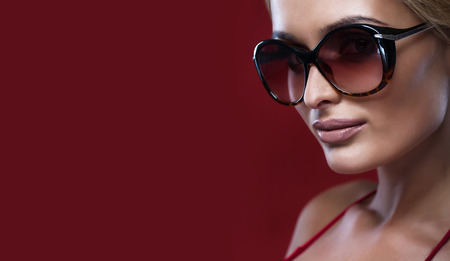 Beauty portrait of sexy blonde woman in sunglasses.