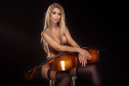 nude women: Sexy beautiful naked woman posing with cello.
