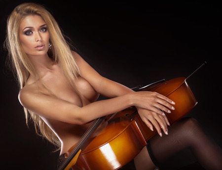 nude blonde woman: Sexy beautiful naked woman posing with cello.