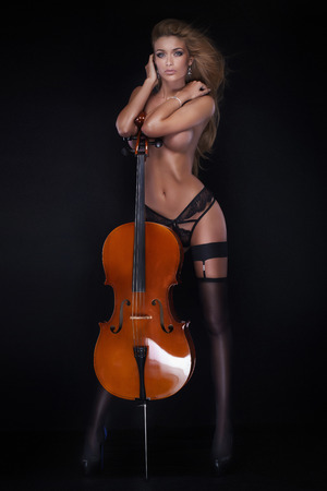 nude: Sexy beautiful naked woman posing with cello.