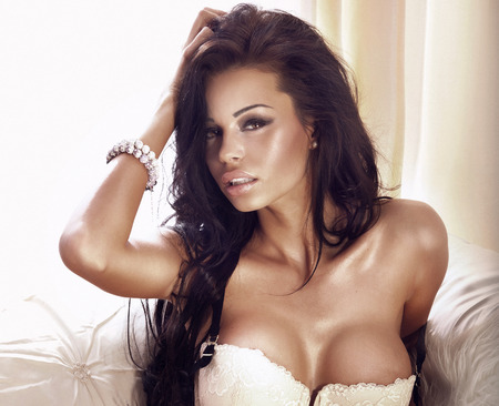 nice breast: Sexy beautiful brunette woman posing in lingerie. Girl with long healthy hair.