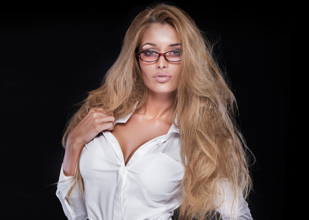 Portrait of sexy blonde businesswoman with eyeglasses.