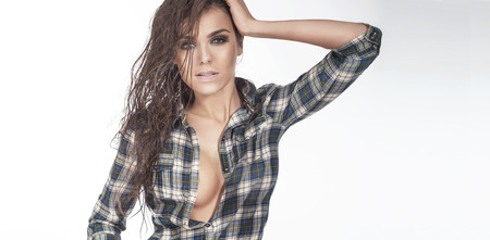 Portrait of young beautiful girl with perfect makeup and wet hair. Summer style. photo