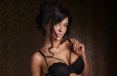 woman bra: Portrait of elegant sexy brunette woman. Studio shot.