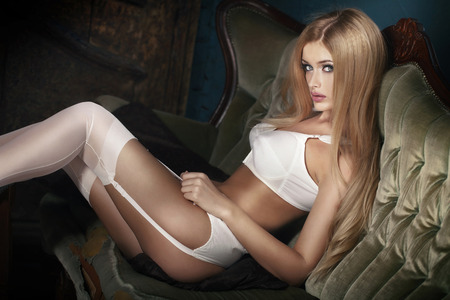 breasts erotic: Elegant blonde woman posing in sexy lingerie, looking at camera.