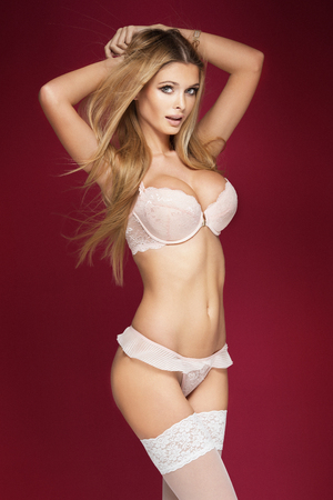 sensual nude: Blonde sexy woman with perfect slim body posing in sensual lingerie. Girl with long hair. Stock Photo