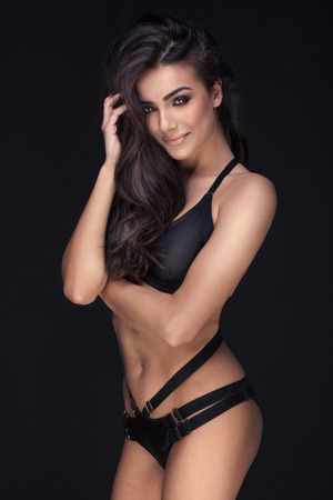 nude: Sensual romantic woman posing in black lingerie, smiling to the camera. Stock Photo