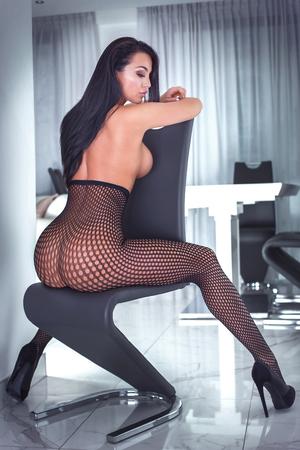Sensual beautiful lady posing in elegant lingerie. Modern room. Perfect body.