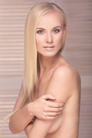nude blonde woman: Natural beautiful blonde woman with blue eyes. Portrait.