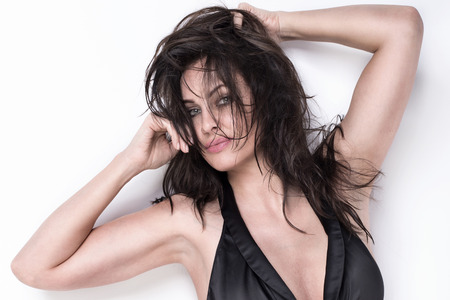 sexy model: Closeup portrait of attractive brunette woman. Studio shot.
