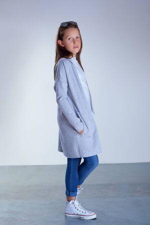 cute teen girl: Young teenager girl posing in fashionable clothes. Studio shot. Фото со стока