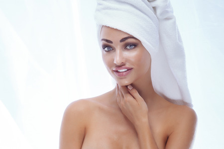 nude girl pretty young: Portrait of sexy woman with white towel on head. Studio shot. Stock Photo