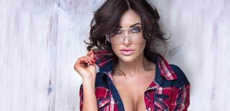 hair styling: Portrait of sexy brunette woman looking at camera. Stock Photo