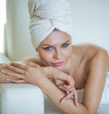 towel head: Portrait of natural young woman with white towel on head. Spa concept. Stock Photo