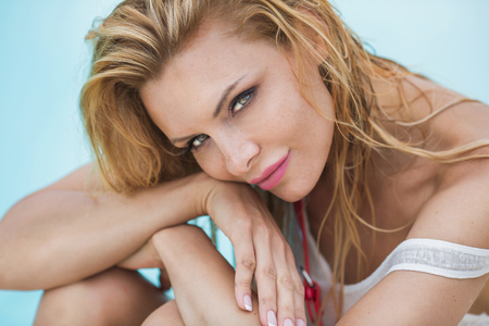 freckles: Portrait of young blonde natural woman with freckles on her face. Sunny summer day. Stock Photo