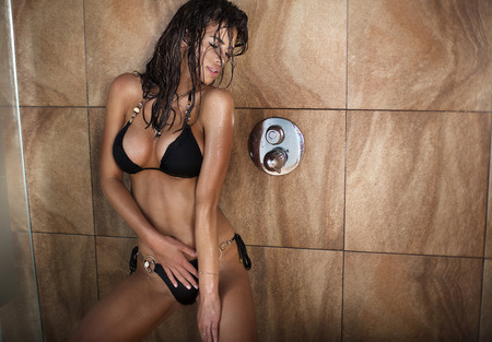 aqua naked: Sensual woman with ideal body posing under shower, wet hair. Stock Photo