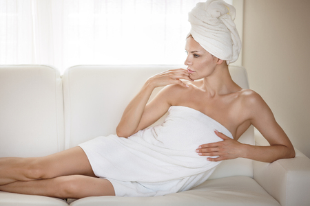 Natural beautiful woman wrapped in towel. Spa concept.