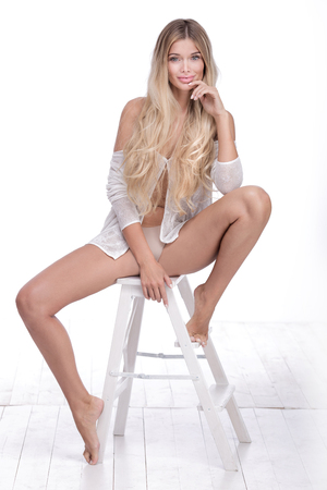 sexy women naked: Photo of blonde beautiful woman with long healthy hair. Natural girl. No makeup. White background. Studio shot.