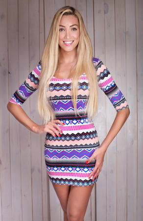 Blonde beautiful woman with long hair posing in fashionable dress. Zdjęcie Seryjne