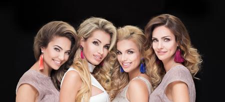 earrings: Portrait of four beautiful adult ladies. Glamour makeup. Elegant look.