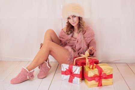 Beautiful woman unpacking christmas gifts.