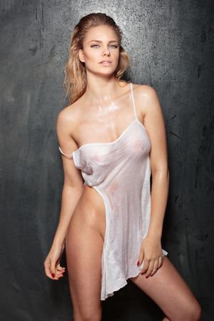 nude sexy woman: Sexy blonde woman with perfect wet body posing in studio. Stock Photo