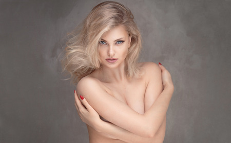 beautiful naked woman: Sensual beautiful blonde woman looking at camera. Stock Photo