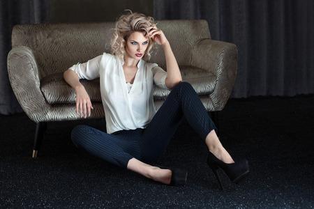 1 person: Elegant blonde attractive woman posing in hotel room.