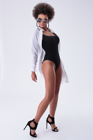 Fashion photo of attractive african american woman posing. Studio shot.