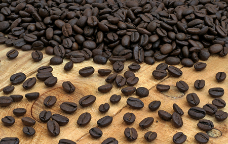 coffee spill: coffee beans spill on the pine boards