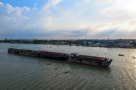 barge: Big barge in the river near Bangkok Thailand