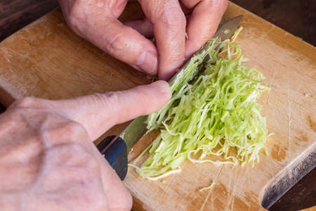 trencher: Cook, chop and slice cabbage vegetable, ingredients of salad and sandwich Stock Photo