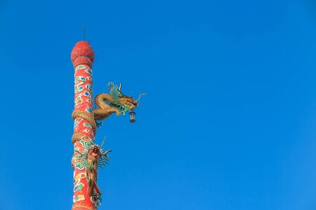chonburi: Green dragon statues on red pole in front of Naja Chinese Temple, Angsila, Chonburi, Thailand
