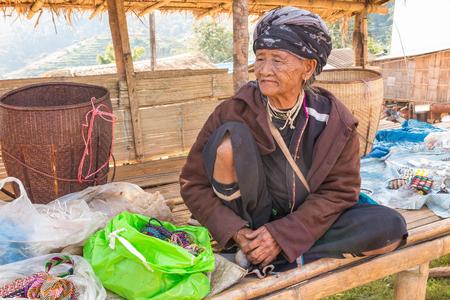 wristlet: DOI ANG KHANG, CHANG MAI, THAILAND - JAN 11, 2016 -  Unidentified old hill tribe woman is at Doi Ang Khang Chiang Mai, Thailand