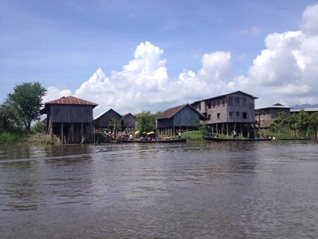 entrapment: INLE LAKE, MYANMAR - MAY 26 : Stilted houses in village on Inle lake, Myanmar on May 26, 2014