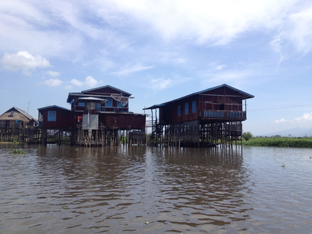 stilted: Stilted houses in village on Inle lake, Myanmar Editorial