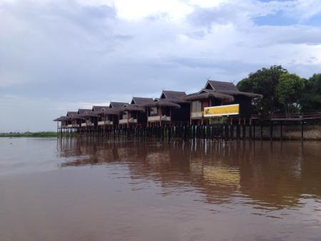 inle: INLE LAKE, MYANMAR - MAY 25, 2013 : Paramount Inle Resort, Over Water villa cottage style in Inle Lake Editorial
