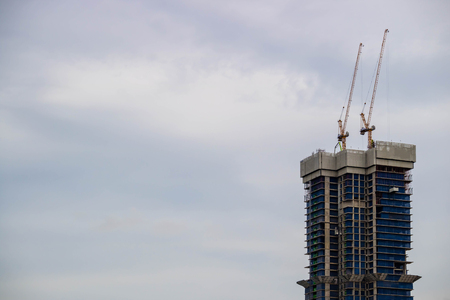 high tech: Crane and construction site building with twilight evening sky Stock Photo