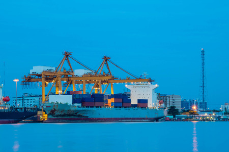 unloading: Shipping trade port. Container cargo ship loading or unloading by crane bridge. Logistics industrial and transportation business background