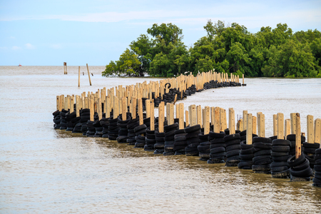 Sea wave protection barrier, breakwater, made from tire, protect mangroove forest and coast