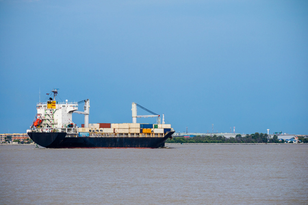 Cargo ship, International import export container vessel float on ocean, Logistics and transportation background