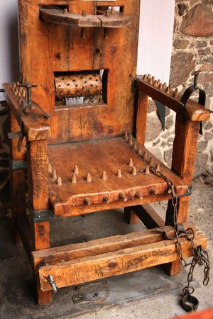 throe: Medieval wooden chair used to torture people