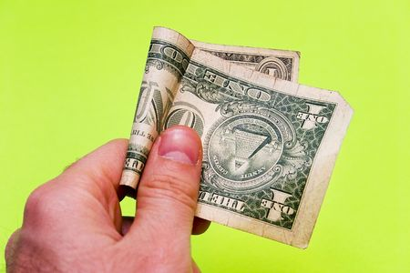 dollarbill: Mans hand offering one dollar bill on a green background