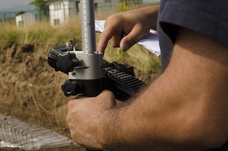 geodesist: Geodesist working with gps at a terrain