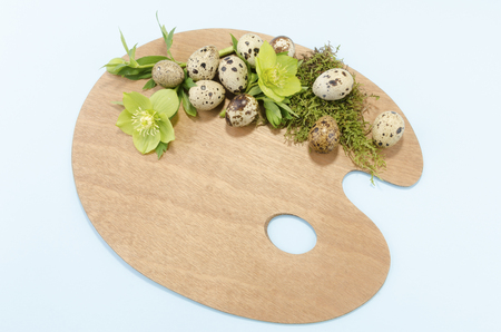resurrect: Easter decoration with palette with quail eggs and hellebore
