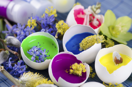 resurrect: Gorgeous Easter decoration with egg shells and paints. Selective focus