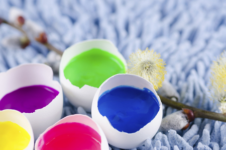 tempera: Easter decoration with egg shells and filled with tempera paints. Selective focus