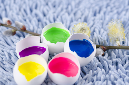 tempera: Easter colorful decoration with egg shells and spring flowers. Selective focus